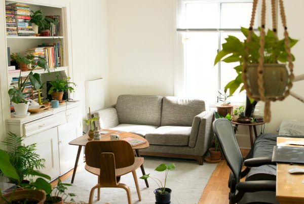Small room showing a rug and sofa, office desk and cupboard